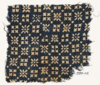 Textile fragment with rosettes, dots, and squares