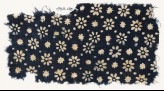 Textile fragment with rosettes, stars, and dots (EA1990.120)