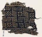 Textile fragment with bandhani, or tie-dye, imitation and rosettes (EA1990.128)