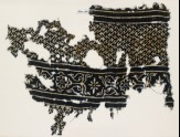 Textile fragment with linked chevrons and flowers, possibly from a garment (EA1990.136)