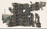 Textile fragment with bands of vines, rosettes, and diamond-shapes (EA1990.138)