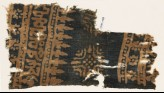 Textile fragment with Arabic-style script, rosettes, and stylized trees or foliage