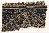 Textile fragment with dotted zigzags, leaves, and rosettes (EA1990.155)
