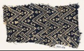 Textile fragment with large chevrons, dots, S-shapes, and stars (EA1990.156)