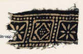 Textile fragment with squares, rosettes, and a diamond-shape (EA1990.159)