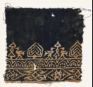 Textile fragment with birds, possibly tree-shapes, and stylized plants (EA1990.167)