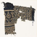 Textile fragment with stylized trees and flowers, a rosette, and leaves