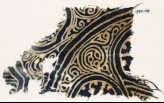 Textile fragment with swirling tendrils (EA1990.193)
