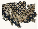 Textile fragment with part of a large medallion with a grid, dots, and a vine