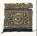 Textile fragment with medallion, and rosettes set into linked stars (EA1990.197)
