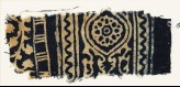Textile fragment with medallion, and a vine with leaves and flowers