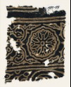Textile fragment with ornate rosette, and tendrils with flower-heads (EA1990.199)