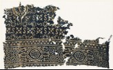 Textile fragment with S-shapes, quatrefoils, and rosettes set into linked stars