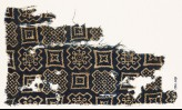 Textile fragment with squares, stepped squares, stars, and crosses (EA1990.209)