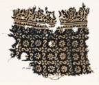 Textile fragment with reversed S-shapes, rosettes, and flowers (EA1990.21)