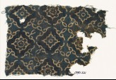 Textile fragment with lobed diamond-shapes and stylized leaves (EA1990.221)