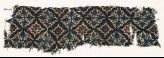 Textile fragment with lobed diamond-shapes and leaves (EA1990.222)