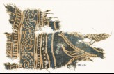 Textile fragment with dotted vine and part of a design of arches (EA1990.232)