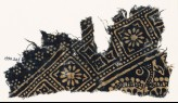 Textile fragment with squares and rosettes (EA1990.245)