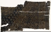 Textile fragment with rosettes, squares, and part of two medallions (EA1990.246)