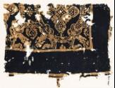Textile fragment with medallions and large quatrefoils (EA1990.249)