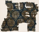 Textile fragment with peacocks and trees in roundels (EA1990.257)
