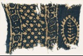 Textile fragment with vines, dots in a grid, and probably a leaf (EA1990.261)