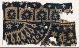 Textile fragment with trees, stars, and radiating shapes (EA1990.262)
