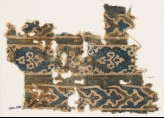 Textile fragment with bands of flowers and elaborate chevrons (EA1990.276)