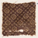Textile fragment with rosettes in a grid of stars and dots (EA1990.280)