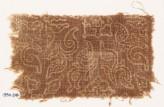 Textile fragment with stylized plants and quatrefoils