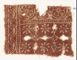 Textile fragment with rosettes and crosses (EA1990.333)