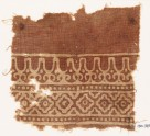 Textile fragment with linked diamond-shapes and stylized leaves (EA1990.349)