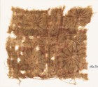 Textile fragment with rosettes in a grid (EA1990.372)