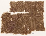 Textile fragment with flower-heads, stars, and squares (EA1990.373)