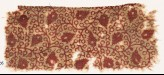 Textile fragment with linked tendrils and flower-heads (EA1990.406)