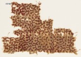 Textile fragment with linked tendrils and leaves (EA1990.420)