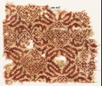 Textile fragment with squares, crosses, dots, and tendrils (EA1990.425)
