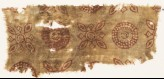 Textile fragment with rosettes and quatrefoils (EA1990.430)