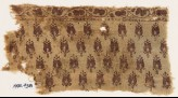 Textile fragment with stylized flower-heads (EA1990.438)