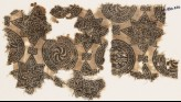 Textile fragment with spirals in braided circles, and stars (EA1990.440)