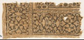 Textile fragment with floral patterns, leaves, and interlace (EA1990.454)