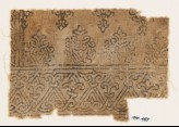 Textile fragment with tendrils forming interlace (EA1990.455)