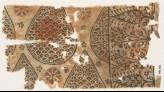 Textile fragment with tear-drops filled with scales, and stylized trees and flowers (EA1990.467)
