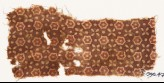 Textile fragment with stars, quatrefoils, and dots (EA1990.473)