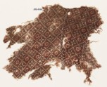 Textile fragment with grid of dots, circles, and rosettes, probably from a garment (EA1990.478)