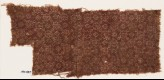 Textile fragment with rosettes, dots, and small squares (EA1990.487)