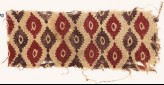 Textile fragment with indented ovals (EA1990.500)