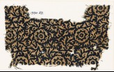 Textile fragment with swirling leaves and flowers (EA1990.52)
