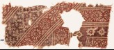 Textile fragment with rosettes, serrated crosses, stars, and dots (EA1990.525)